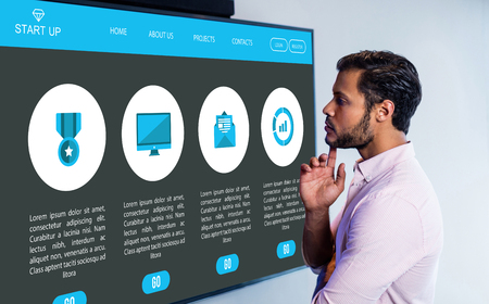 looking over: Various icons on website against thoughtful man looking over whiteboard