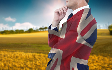 great suit: Elegant businessman in suit posing  against digitally generated great britain national flag Stock Photo