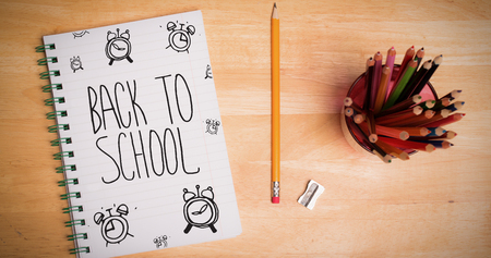 parer: Back to school message with alarms against students desk