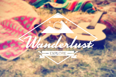 weekend activities: Wanderlust word against empty campsite at music festival