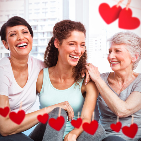 Hearts on line against cheerful fit women in yoga class photo