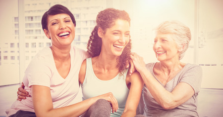Cheerful fit women sitting in the yoga class photo
