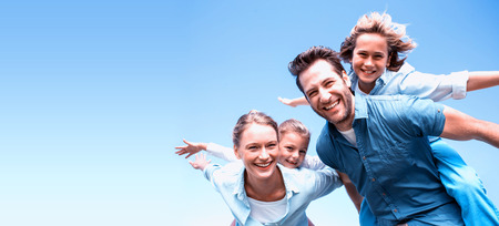 Happy parents with their children in the countryside Stock Photo - 61782164