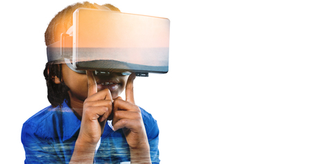 waves crashing: Boy using virtual reality simulator  against waves crashing at sunset