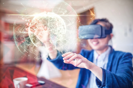 virtual technology: Global technology background in green against young woman using virtual reality glasses