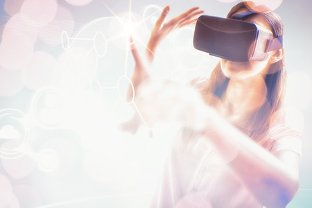 Woman gesturing while virtual reality simulator against blue background