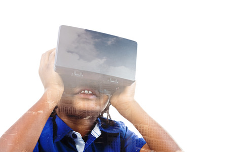 virtual reality simulator: Boy wearing virtual reality simulator against aerial view of a city on a cloudy day