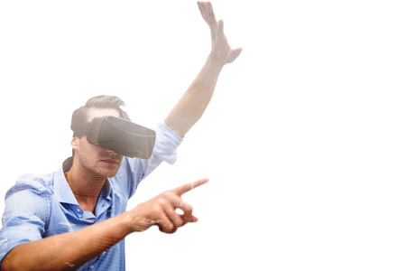 virtual reality simulator: Man pointing while wearing virtual reality simulator against aerial view of a city on a cloudy day