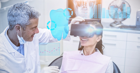 surgical mask: Digitally generated image of a teeth against female patient virtual reality headset during a dental visit Stock Photo