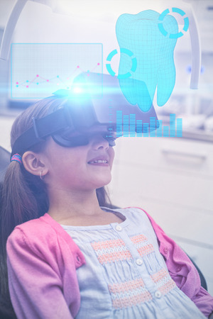 digitally generated image: Digitally generated image of a teeth against girl using virtual reality headset during a dental visit Stock Photo