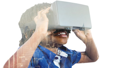virtual reality simulator: Boy wearing virtual reality simulator  against image of a city landscape on a sunny day