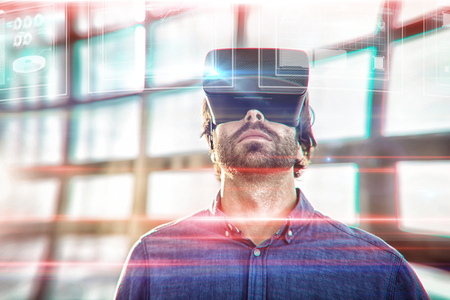 Business interfaces against male business executive using virtual reality headset Stock Photo