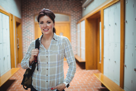 locker room: Portrait of mature student standing in the locker room at college
