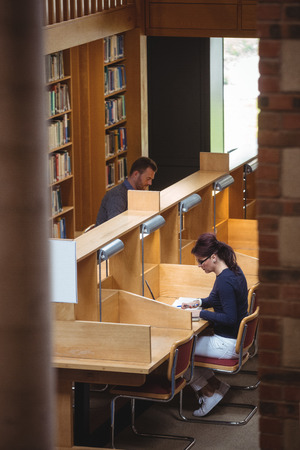 mature student: Mature student studying in library at the college Stock Photo