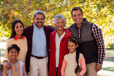 multigeneration: Portrait of happy multi-generation family standing at park during autumn Stock Photo