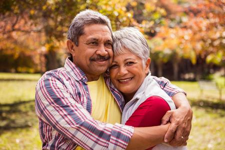 gets: Smiling elderly couple gets hugs