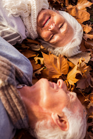 Senior couple lying on the ground in a park Stock Photo