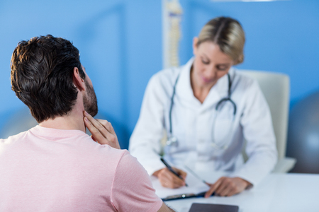 interacting: Physiotherapist interacting with patient in clinic