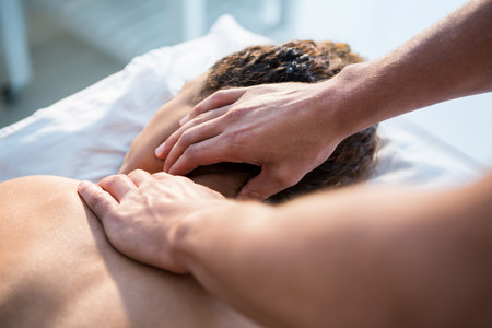 neck massage: Physiotherapist giving neck massage to a woman in clinic