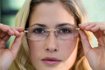 trial indoor: Close-up of female customer trying spectacles in optical store Stock Photo