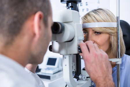 ophthalmology: Optometrist examining female patient on slit lamp in ophthalmology clinic