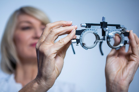 ophthalmology: Female optometrist looking at messbrille in ophthalmology clinic