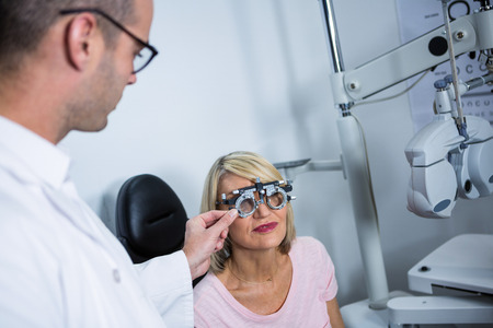 optometrist: Optometrist examining female patient with messbrille in ophthalmology clinic
