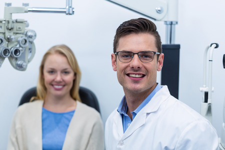 ophthalmology: Portrait of optometrist and female patient in ophthalmology clinic