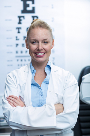 ophthalmology: Portrait of beautiful female optometrist smiling in ophthalmology clinic Stock Photo
