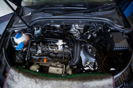 servicing: Cars with open hood for servicing at repair garage