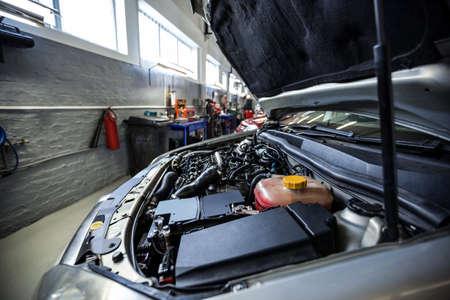 engine bonnet: Close-up of car bonnet at repair garage