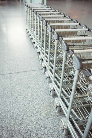 kept: Trolleys kept in a row in airport terminal