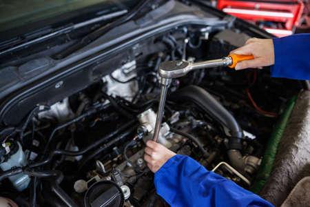 servicing: Mechanic servicing car engine at the repair garage