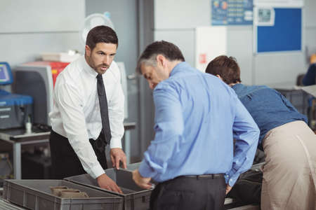 security check: Passengers in security check at airport