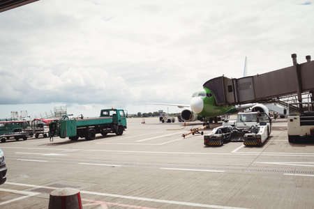 moveable: Airplane with loading bridge getting ready for departure at airport terminal LANG_EVOIMAGES