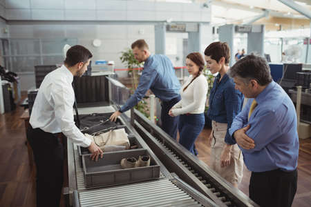 airport security: Passengers in airport security check at airport