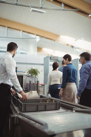 security check: Passengers passing through security check at airport LANG_EVOIMAGES