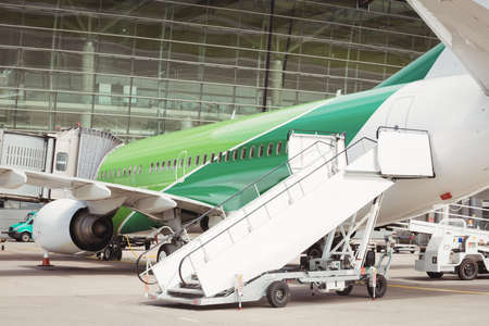 steps and staircases: Airplane with airstair at airport