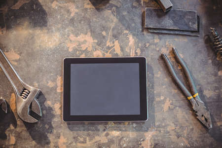 wireless tool: Digital tablet and tools on a table in workshop