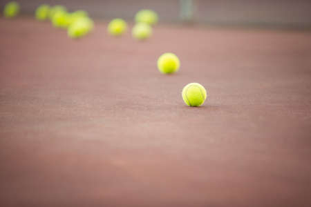 athleticism: Tennis balls lying in the court