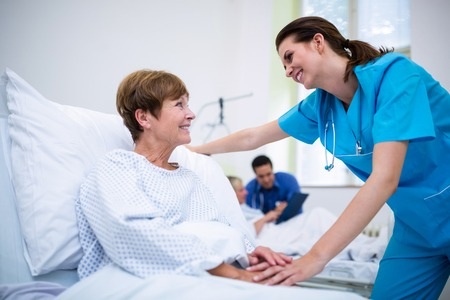 consoling: Nurse consoling a patient in ward at hospital Stock Photo