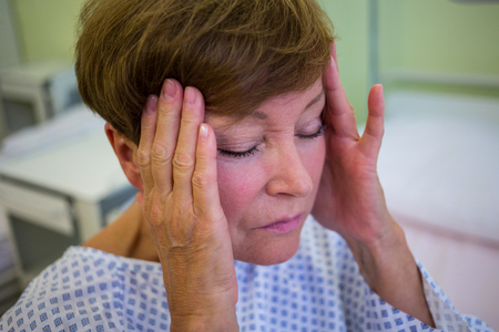 tensed: Close-up of tensed senior patient in hospital room