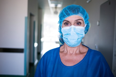 surgical light: Portrait of surgeon standing in corridor at hospital
