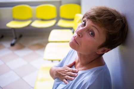 afflict: Patient sitting in a waiting room of a hospital Stock Photo
