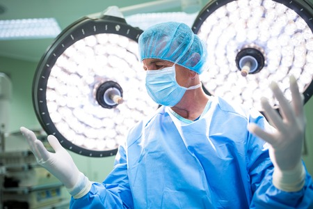 Surgeon preparing for operation in operation room at the hospital