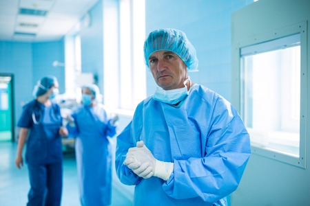 Portrait of surgeon standing in operation room at hospital