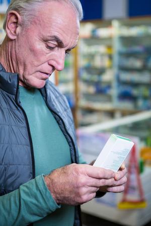 pill box: Customer checking a pill box in pharmacy