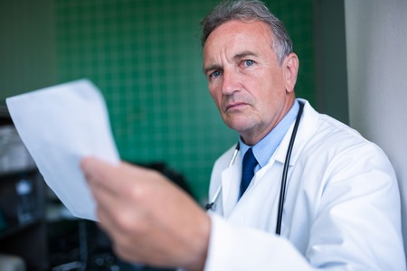 Doctor holding a report in hospital