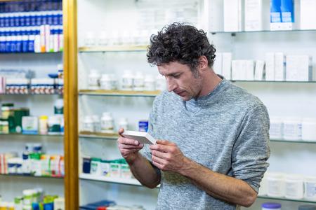 medicine box: Customer checking a medicine box in pharmacy Stock Photo