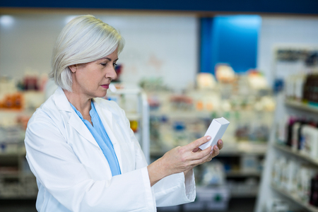 medicine box: Pharmacist checking a medicine box in pharmacy